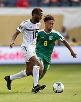 KANSAS CITY, KS - JUNE 26: Kevin Molino #10 and Samuel Cox #8 contest the ball during a game between Guyana and Trinidad