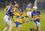 Clare's Colin Ryan falls under pressure. Photograph by Declan Monaghan