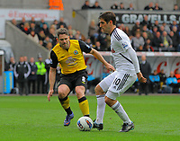 FAO SPORTS PICTURE DESK<br /> Pictured: Danny Graham of Swansea (R) against David Dunn (L) of Blackburn Rovers. Saturday, 14 April 2012<br /> Re: Premier League football, Swansea City FC v Blackburn Rovers at the Liberty Stadium, south Wales.