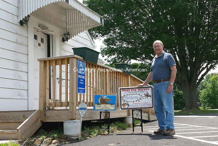 """WOLCOTT, CT - June 9, 2015 - 060915AL01 - Joe Discepolo, a volunteer with the Wolcott Resource Center, holds a sign advertising a 'Meet the Horses' food drive and fundraiser from 9 a.m. to 1 p.m. June 20 on the Frisbie School field. The organization, which runs the Wolcott Food Pantry, has placed signs that say """"The Horses are Coming"""" throughout town."""