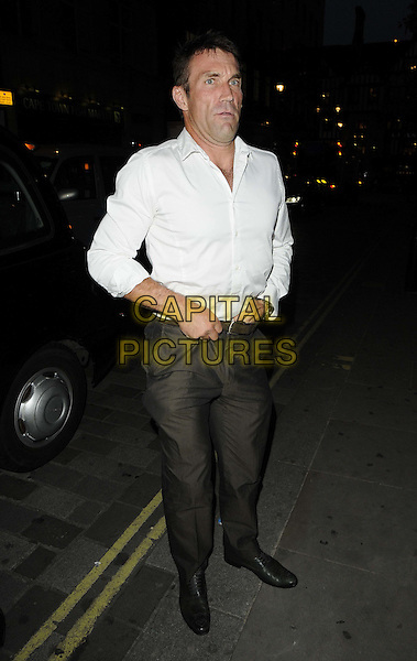 Pat Cash.The Slazenger Wimbledon Party, Aqua Nueva, Argyll St., London, England..June 28th, 2012.full length white shirt grey gray trousers funny tucking in hand in waist .CAP/CAN.©Can Nguyen/Capital Pictures.