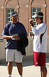 Jack Thompson, former Cougar and NFL quarterback, discusses strategy with the Washington State Cougars' new head football coach Paul Wulff after practice on August 10, 2008, in Pullman, Washington.