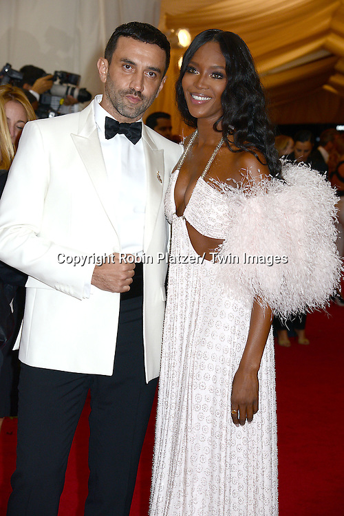 Naomi Campvell and date attends the Costume Institute Benefit on May 5, 2014 at the Metropolitan Museum of Art in New York City, NY, USA. The gala celebrated the opening of Charles James: Beyond Fashion and the new Anna Wintour Costume Center.