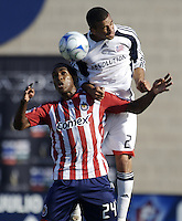 The Chivas USA forward Atiba Harris (24) and NE Revolution defender Amaechi Igwe (2) battle for a ball. The Chivas USA and New England Revolution played to 1-1 draw during an early round of the 2008 SuperLiga at Cal State Fullerton Titan stadium in Fullerton, California on Sunday July 20, 2008.