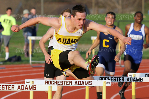 Jordan Shive, Rochester Adams, clears a hurdle in the 300-meter hurdle event during Oakland Activities Association varsity track action at Rochester High School Thursday, May 8, 2014. Shive took first place in both the 300 and 110-meter hurdle events. OAA Track Invitational at Rochester Adams High School, May 8, 2014. Photos: Larry McKee, L McKee Photography. L McKee Photography, Clarkston, Michigan. L McKee Photography, Specializing in Action Sports, Senior Portrait and Multi-Media Photography. Other L McKee Photography services include business profile, commercial, event, editorial, newspaper and magazine photography. Oakland Press Photographer. North Oakland Sports Chief Photographer. L McKee Photography, serving Oakland County, Genesee County, Livingston County and Wayne County, Michigan. L McKee Photography, specializing in high school varsity action sports and senior portrait photography.For The Oakland Press / LARRY McKEE