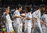 """Real Madrid's French forward Karim Benzema celebrates after scoring during the """"El clasico"""" Spanish League football match Real Madrid vs Barcelona at the Santiago Bernabeu stadium in Madrid on March 23, 2014.   PHOTOCALL3000/ DP"""