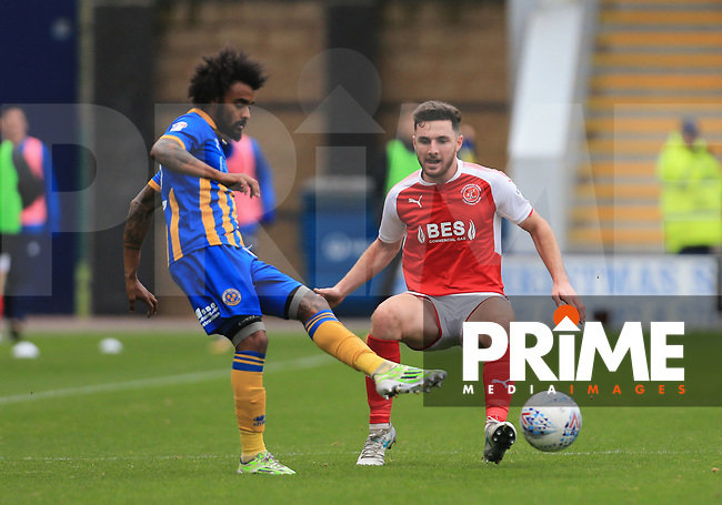 Lewis Coyle of Fleetwood Town loses the ball against Junior Brown of Shrewsbury Town during the Sky Bet League 1 match between Shrewsbury Town and Fleetwood Town at Greenhous Meadow, Shrewsbury, England on 21 October 2017. Photo by Leila Coker / PRiME Media Images.