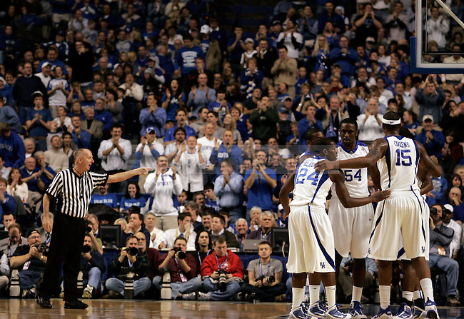 The UK men's basketball team takes a moment to talk in the first half of UK's 2000th win against Drexel at Rupp Arena on Monday, Dec 21, 2009. Photo by Britney McIntosh | Staff