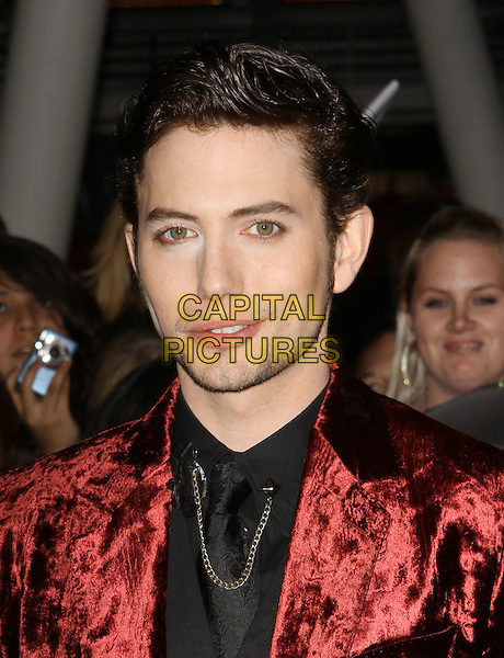 "Jackson Rathbone.""The Twilight Saga: Breaking Dawn Part 1"" Los Angeles Premiere Held At The Nokia Theatre L.A. Live, Los Angeles, California, USA, 14th November 2011..portrait headshot tie chain  red velvet suit black shirt  .CAP/ADM/KB.©Kevan Brooks/AdMedia/Capital Pictures."