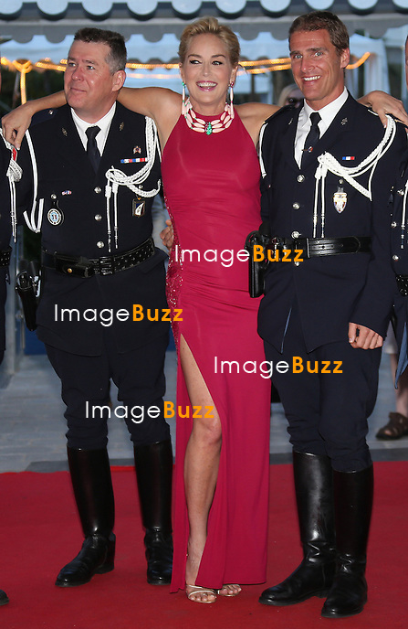 Sharon Stone leaving a yacht and posing with French cops during 67th Cannes Film Festival, on May 20, 2014 in Cannes, France.