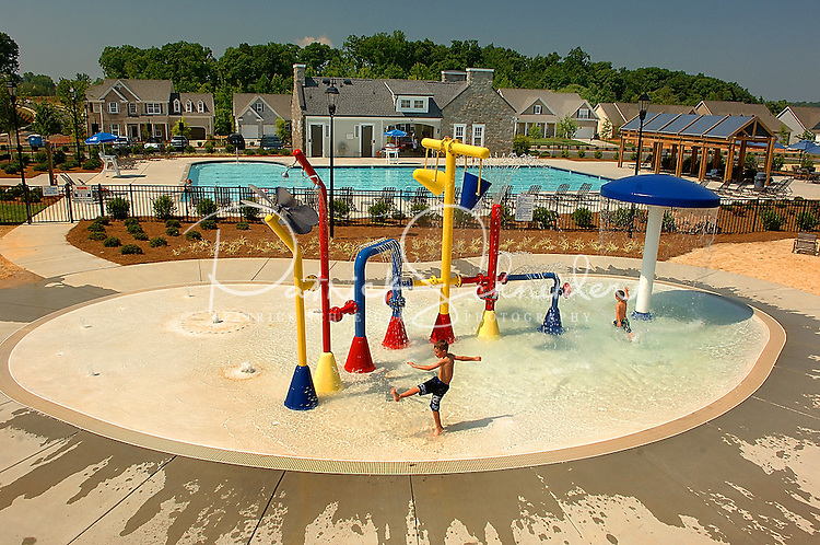 Children play in a swimming pool at Berewick master-planned community in southwest Mecklenburg County, Charlotte, NC. The property is developed by Pappas Properties.