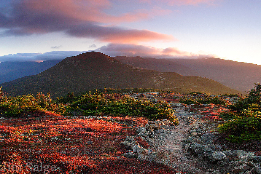 The Crawford Path weaves its way across the spine of the Southern Presidentials, and is the oldest footpath in the United States.  In autumn, the alpine tundra transforms into a beautiful carpet of color, and I was fortunate to catch the first sunrise of the fall season from Mount Pierce to capture it!