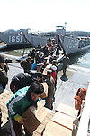 OSHIMA, Japan - Marines of the 31st Marine Expeditionary Unit, Sailors with Amphibious Squadron 11, Japanese Ground Self Defense Forces, and local citizens unload food and water from a U.S. Navy landing craft, March 27. The 31st MEU and PHIBRON-11 picked up Japanese utility repair vehicles from the port in Kessenuma and delivered food, water, comfort items and the vehicles to residents on this isolated island. The island of Oshima has been cut off from the mainland since the earthquake and tsunami March 11. The operation demonstrated the expeditionary capabilities in ship-to-shore amphibious operations. Marines and Sailors of the 31st MEU are conducting humanitarian aid and disaster relief missions in northeast Japan assisting the Japanese Self Defense Forces in their ongoing operations. (Photo by USMC/AFLO) [0006]