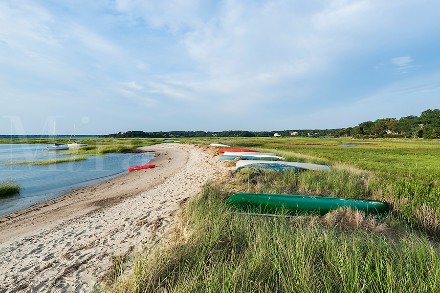 Canoes lined up on Boat Meadow Beach, Eastham, Cape Cod, Massachusetts, USA