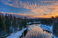 Reflection of clouds in the Seine River at sunrise<br />Near Mine Centre<br />Ontario<br />Canada