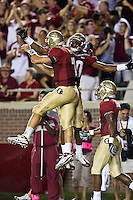 October 10, 2009:     Florida State quarterback Christian Ponder (7) and Jarmon Fortson (80) celebrate a touchdown during Atlantic Coast Conference action between the Georgia Tech Yellow Jackets and Florida State Seminoles at Doak Campbell Stadium in Tallahassee, Florida.