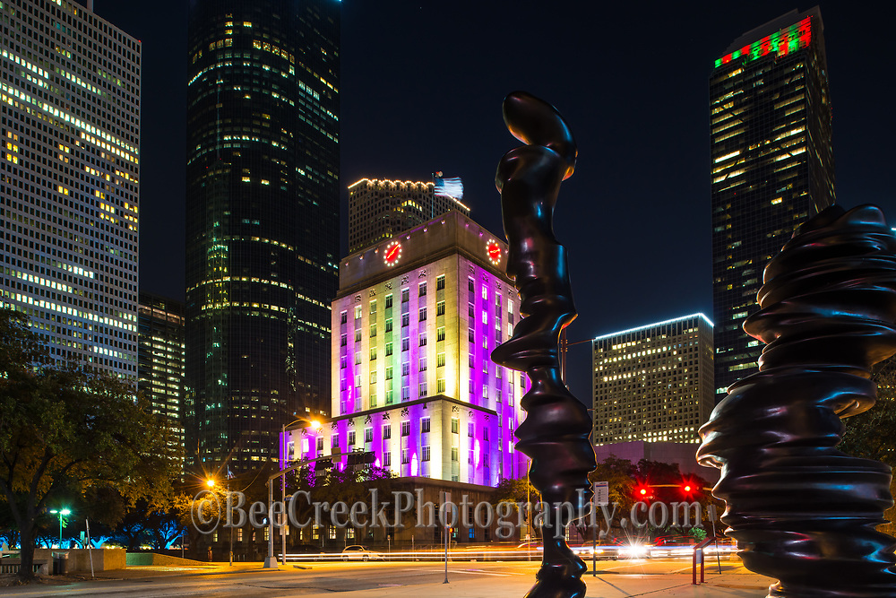 This colorful building is the Houston City Hall which lights up into a constantly changing light show.  We took this photo from across the street using the art statues at the Hobby Center to frame the shot.  Our biggest problem was deciding which color phase to use.