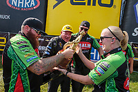 Sep 3, 2018; Clermont, IN, USA; NHRA top fuel driver Terry McMillen (center) celebrates with his crew after winning the US Nationals at Lucas Oil Raceway. Mandatory Credit: Mark J. Rebilas-USA TODAY Sports