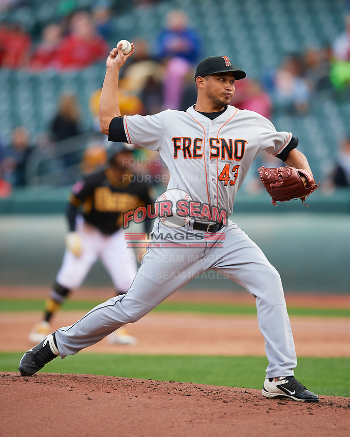 David Martinez (43) of the Fresno Grizzlies delivers a pitch to the plate against the Salt Lake Bees in Pacific Coast League action at Smith's Ballpark on April 17, 2017 in Salt Lake City, Utah. The Bees defeated the Grizzlies 6-2. (Stephen Smith/Four Seam Images)