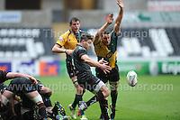 Ospreys Rhys Webb clears the danger. Liberty Stadium, Swansea, South Wales 12.01.14. Ospreys v Northampton Heineken Cup round 5 pool 1 - pIc credit Jeff Thomas photography