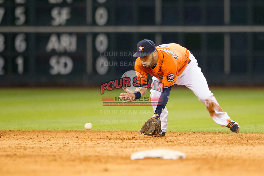 Houston Astros shortstop Marwin Gonzalez (9) fields a ground ball during the MLB baseball game against the Detroit Tigers on May 3, 2013 at Minute Maid Park in Houston, Texas. Detroit defeated Houston 4-3. (Andrew Woolley/Four Seam Images).