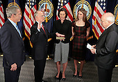 Washington, D.C. - December 20, 2007 -- From left to right: United States President George W. Bush, Secretary of Veterans Affairs James Peake, his wife Janice and daughter Kimberly and Vice President Dick Cheney participate in ceremonial swearing-in for Peake at the Department of Veterans Affairs, Thursday, December 20, 2007 in Washington, DC. Having previously served as the Army Surgeon General, Peake succeeds outgoing secretary, James Nicholson, who resigned after coming under scrutiny for the treatment of wounded troopers from the wars in Iraq and Afghanistan. <br /> Credit: Chip Somodevilla - Pool via CNP