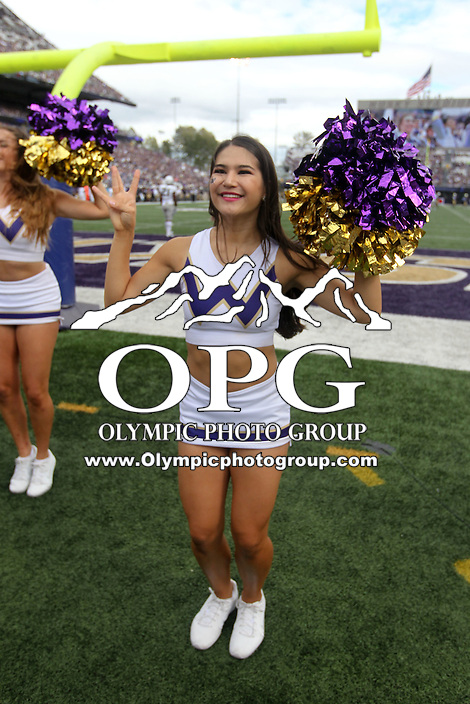 SEP 19, 2015:  University of Washington's cheerleader Karli Berger cheers against Utah State.  Washington defeated Utah State 31-17 at Husky Stadium in Seattle Washington.