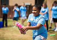 NWA Democrat-Gazette/CHARLIE KAIJO Avyah Dansby, 10, transports water in an engineering challenge where students work together to transport water with a group-made water transport device during a STEM camp, Monday, June 11, 2018 at Bonnie Grimes Elementary School in Rogers.<br />