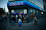 Pedestrians walk next to a Citibank branch in New York. 16/10/2012. The Board of Directors of Citigroup announced that Vikram Pandit has stepped down as the Company's CEO and it has unanimously elected Michael Corbat as new CEO and a director of the Board. Photo by Eduardo Munoz Alvarez / VIEWpress.