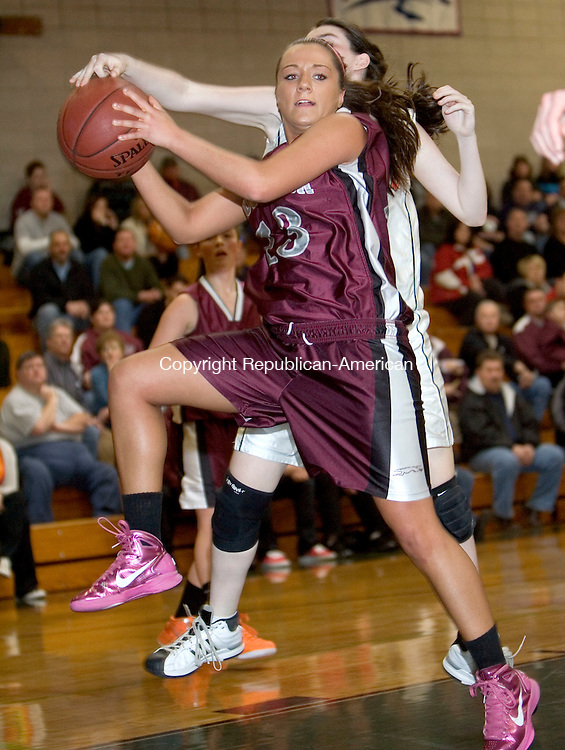 WATERBURY, CT. 18 February 2012-021812SV02-#13 Lauren Piroscafo of Naugatuck High pulls down the rebound as #31 Maggie Collier of Watertown High defends during the girls NVL basketball tournament at Holy Cross High in Waterbury Saturday.  .Steven Valenti Republican-American