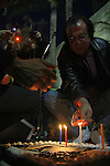 "GEORGE HARRISON BIRTHDAY CAKE. A candle is lit on the birthday cake at the George Harrison Public Birthday Celebration by the Alliance for Survival, hosted by Jerry Rubin and ""Breakfast with the Beatles"" radio host Chris Carter at George Harrison's star on the Walk of Fame. Hollywood, CA, USA. February 25, 2010."