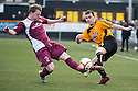 Arbroath's Mark Baxter challenges Alloa's Darryl Meggatt.