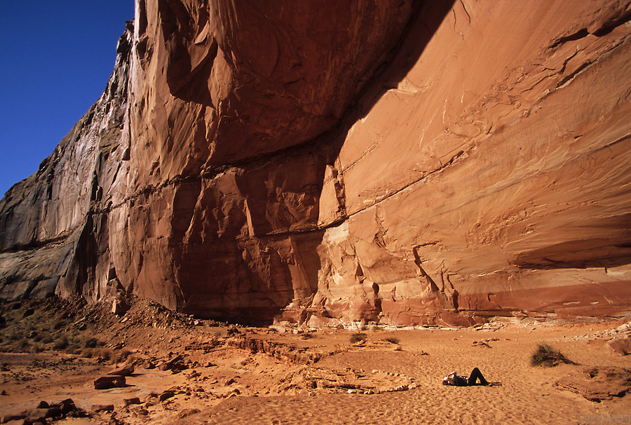 A visitor searches for pictographs and petroglyphs in Horseshoe Canyon, part of Canyonlands National Park in Utah.