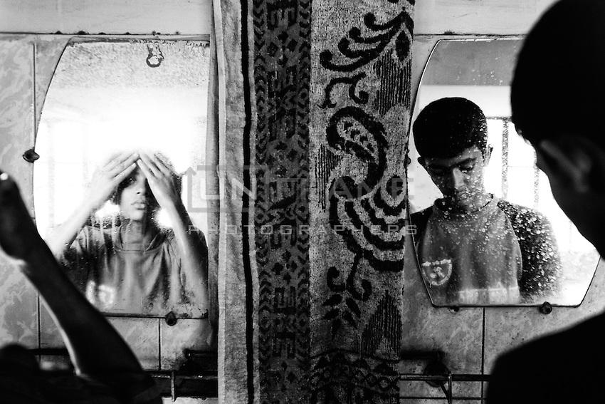 Boys wash their faces at morning. Dhaka, Bangladesh.