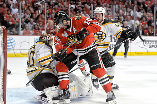12.06.2013 Chicago, USA.  Chicago Blackhawks center Patrick Sharp (10) battles with Boston Bruins goalie Tuukka Rask (40) in action during game one of the Stanley Cup Finals between the Boston Bruins and the Chicago Blackhawks, at the United Center.