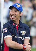 Apichet Srivaddhanaprabha (King Power) smiles after his team win the Cartier Trophy during the Cartier Queens Cup Final match between King Power Foxes and Dubai Polo Team at the Guards Polo Club, Smith's Lawn, Windsor, England on 14 June 2015. Photo by Andy Rowland.