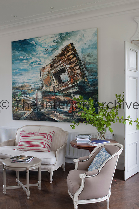 A canvas by John Monks entitled Atlantic Wall dominates one wall of the living room