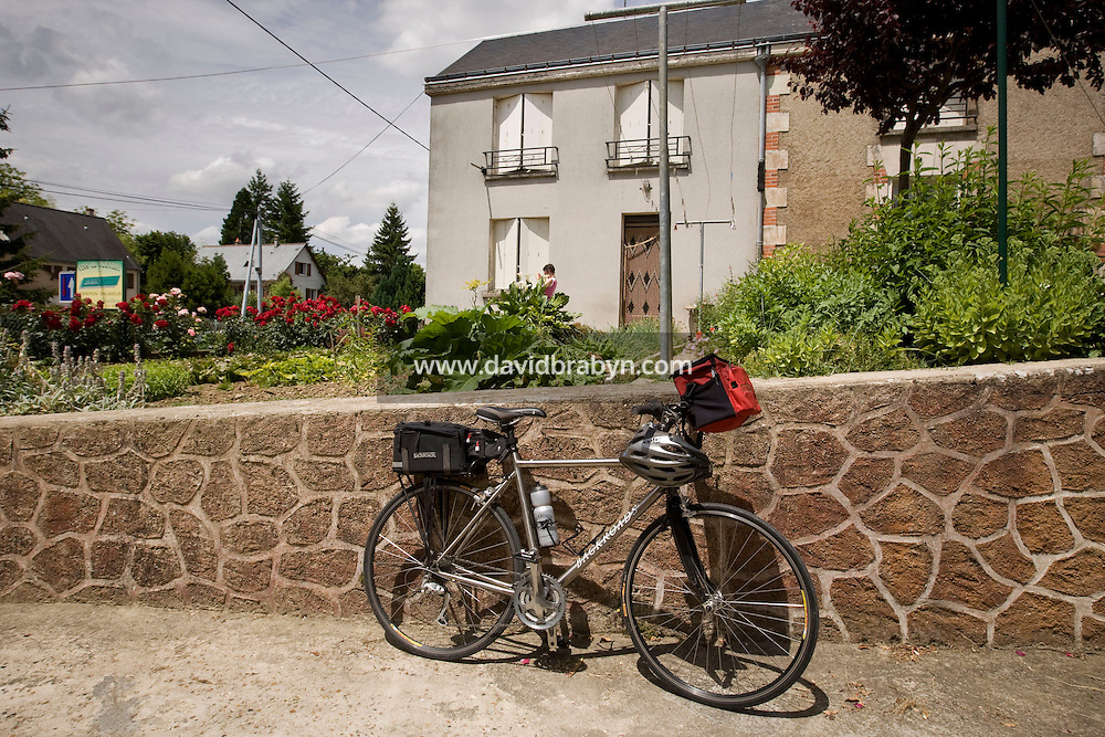 The bicycle of one of the participants in a Backroads cycle tour of the Loire Valley stands outside winemaker Daniel Jarry cellars in Vouvray, France, 26 June 2008.