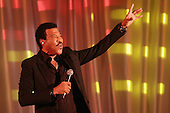 American singer Lionel Richie performs 'Easy' during a dinner on the occasion of the U.S.-Africa Leaders Summit on the South Lawn of the White House August 5, 2014 in Washington, DC. President Barack Obama is promoting business relationships between the United States and African countries during the three-day U.S.-Africa Leaders Summit, where 49 heads of state are meeting in Washington. <br /> Credit: Chip Somodevilla / Pool via CNP