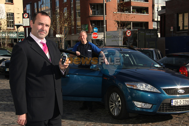 launching Michelin's Fill Up With Air tyre safety campaign. Noel Brett, Chief Exec of the Road Safety Authority'  checking his car tyre pressure with a Michelin tyre pressure gauge..Photo: Fran Caffrey/www.newsfile.ie..