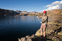 An angler fishes for Yellowstone cutthroat trout at Lower Aero Lake in the Absaroka-Beartooth Wilderness.