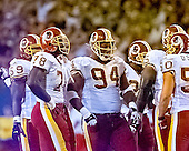 Washington Redskins linebacker Shawn Barber (59), defensive end Bruce Smith (78), defensive tackle Dana Stubblefield (94) and linebacker Derek Smith (50) during a break in the action in the game against the New York Giants at Giants Stadium in East Rutherford, New Jersey on September 24, 2000.  The Redskins won the game 16 - 6.<br /> Credit: Arnie Sachs / CNP