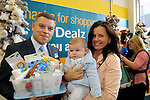 FREE PIC - NO REPRO FEE<br /> 24/09/2015 - Blackpool, Cork<br /> Customer Service Manager David Ginnifer makes a presentation to Karina McGrath from Fairhill, and her son Daniel, the first customer through the door at the official opening of the new Dealz store at Blackpool Retail Park, Cork.<br /> Pic: Brian Lougheed
