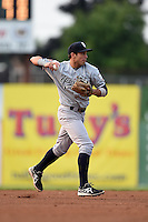 Staten Island Yankees shortstop Vicente Conde (12) throws to first during a game against the Batavia Muckdogs on August 7, 2014 at Dwyer Stadium in Batavia, New York.  Staten Island defeated Batavia 2-1.  (Mike Janes/Four Seam Images)
