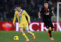 Calcio, semifinale di andata di Coppa Italia: Roma vs Napoli. Roma, stadio Olimpico, 5 febbraio 2014.<br /> Napoli midfielder Jorginho, of Brazil, left, is chased by AS Roma midfielder Kevin Strootman, of the Netherlands, during the Italian Cup first leg semifinal football match between AS Roma and Napoli at Rome's Olympic stadium, 5 FeBruary 2014.<br /> UPDATE IMAGES PRESS/Riccardo De Luca
