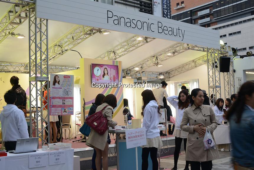 Panasonic Beauty promotional event is held by JR Shinjuku station in Shinjuku, Tokyo.  Young ladies in uniform demonstrates Panasonic new electronic beauty products to young ladies.