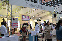 Panasonic Beauty promotional event is held by JR Shinjuku station in Shinjuku, Tokyo.  Young ladies in uniform demonstrates Panasonic new electronic beauty products to young ladies.