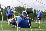 Marcus Hahnemann (below), goalkeeper, fields a shot from goalkeeping coach Phil Wheddon (l) as Milutin Soskic (r) watches on Thursday, May 11th, 2006 at SAS Soccer Park in Cary, North Carolina. The United States Men's National Soccer Team held a training session as part of their preparations for the upcoming 2006 FIFA World Cup Finals being held in Germany.