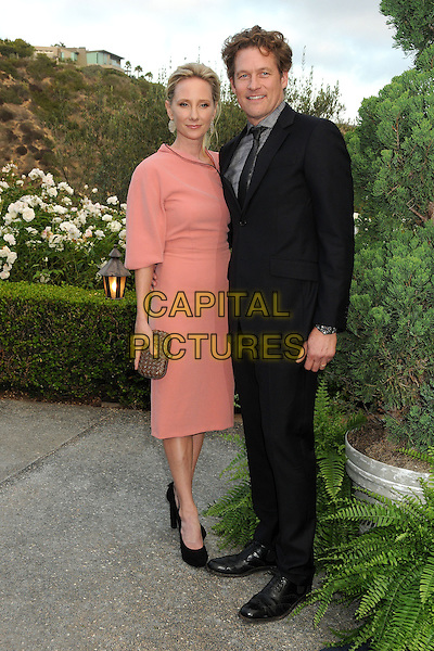 Anne Heche, James Tupper<br /> 6th Annual Oceana SeaChange Gala held at a Private Villa, Laguna Beach, California, USA. <br /> August 18th, 2013<br /> full length pink dress clutch bag gold black shoes suit couple <br /> CAP/ADM/BP<br /> &copy;Byron Purvis/AdMedia/Capital Pictures