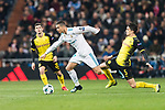 Cristiano Ronaldo of Real Madrid (L) fights for the ball with Borussia Dortmund Defender Marc Bartra (R) during the Europe Champions League 2017-18 match between Real Madrid and Borussia Dortmund at Santiago Bernabeu Stadium on 06 December 2017 in Madrid Spain. Photo by Diego Gonzalez / Power Sport Images